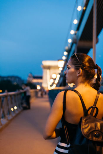 Summer vibes Back Blue Bridge Brunette Budapest Casual Clothing Chain Bridge Focus On Foreground Girl Hungary Leisure Activity Lifestyles Portrait Of A Woman Profile Shoulder Summer Nights Summervibes Sunset Vibes Warm People And Places