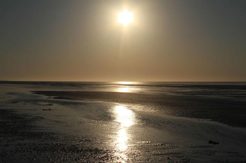 Breathtaking view of a mesmerising golden sunset Golden Sunset Beach Beauty In Nature Bright Sun Day Horizon Horizon Over Water Idyllic Landscape Metallic Nature No People Outdoors Reflection Sand Scenics Sea Sun Sunbeam Sunlight Sunset Tide Out Tranquil Scene Tranquility Water