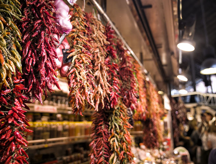 Close-Up Of Dry Peppers For Sale At Market Stall