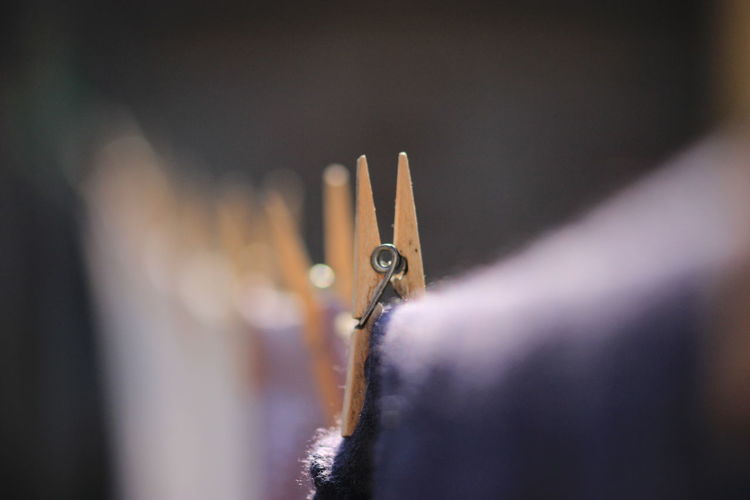 Close-up of clothespin on clothing