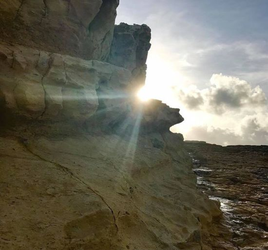 JeanneRotaMatthews Power In Nature Rock - Object Rock Formation Geology Nature Sunbeam Beauty In Nature Sun Cliff Sunlight Landscape Sky Scenics Physical Geography Tranquility Travel Destinations Natural Arch Cave No People Outdoors Low Angle View EyeEmCaribbean EyeEmNewHere EyeEm Gallery