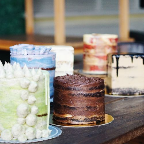 Variety Of Cakes On Wooden Table