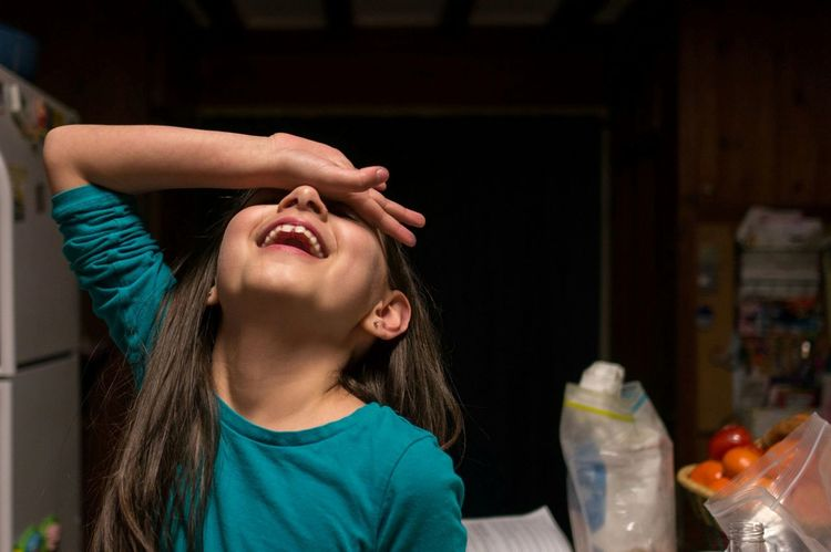 oh my. Kid Child Exaggerated Home Family Dark Background Blue Shirt Girl Expression Hand Over Face Head Back Fainting Acting Silly Playing