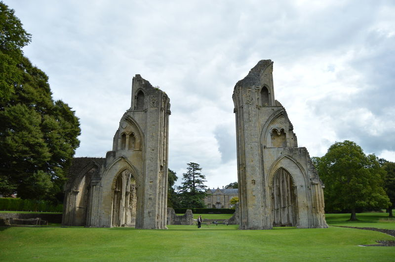Low Angle View Of Glastonbury Abbey Against Cloudy Sky