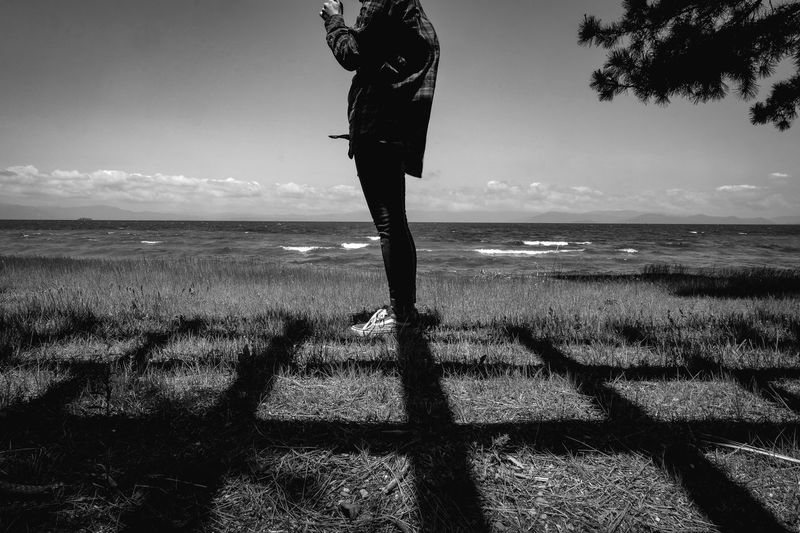 monochrome photography Monochrome Water Sky Sea Beach Horizon Land Horizon Over Water Nature Sunlight One Person Beauty In Nature Tranquility Shadow Tranquil Scene Scenics - Nature Standing Real People Day Lifestyles Outdoors