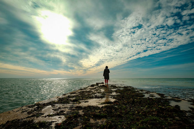 Sea Sky Water Cloud - Sky Horizon Horizon Over Water Beach Land Scenics - Nature Rear View Beauty In Nature One Person Nature Full Length Standing Real People Leisure Activity Tranquility Outdoors Looking At View
