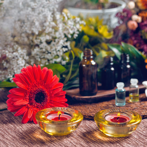 Aromatherapy Aromatherapy Aromatherapy Oil Essential Oils Orange Red Bottles Spa Wellness Relax Glass Therapy Blue Natural Aromatic Brown Care Treatment Healthy Perfume Candles Essence Green Fragnance Organic Health Aroma Fresh Alternative Relaxation Lifestyle Decoration Cosmetic Ingredient Skincare No People Square Flower Fragility Table Nature Indoors  Freshness Close-up Inflorescence Bottle
