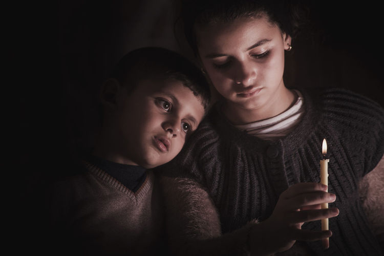 warm kindle Calm Children Kids Kindle Fire Black Background Bonding Boys Brother & Sister Casual Clothing Child Childhood Dark Emotion Family Feelings Females Girls Headshot Holding Indoors  Innocence Kindle Lifestyles Lowkey  Moody Play Portrait Positive Emotion Real People Sibling Sister Teenager This Is Family Togetherness Two People Warm Light Women First Eyeem Photo