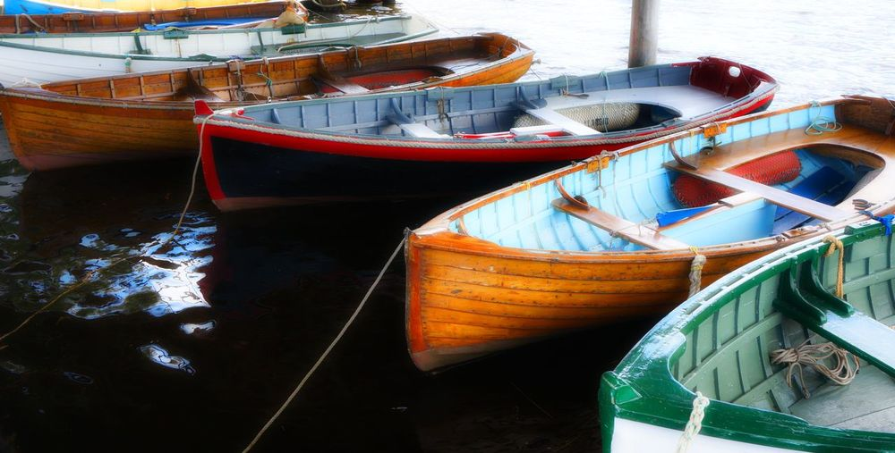 Close-up of boats moored in water