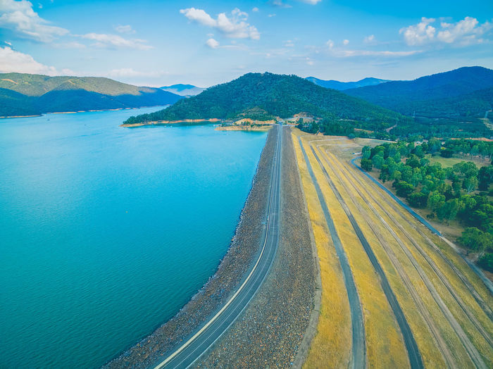 Aerial view of road crossing Lake Eildon Dam in Melbourne, Australia Australia Australian Australian Landscape Drone  Nature Scenic View Aerial Aerial View Beauty In Nature Cloud - Sky Dam Day Drone Photography Eildon Lake Lake Eildon Landscape Mountain Mountain Range Nature No People Outdoors Park Road Scenics Sea Sky The Way Forward Tranquil Scene Tranquility Transportation Travel Destinations Water