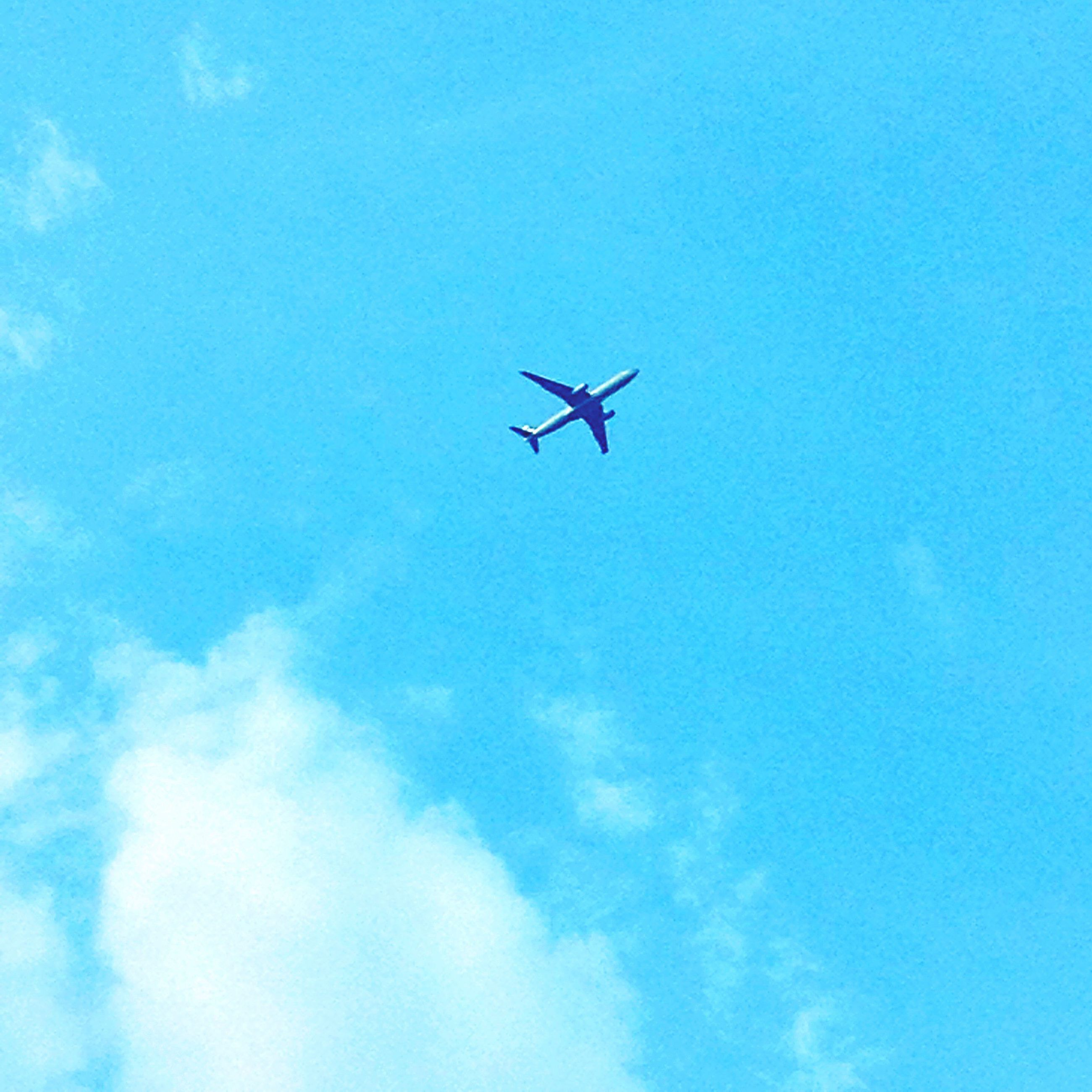 flying, airplane, air vehicle, transportation, mode of transport, low angle view, mid-air, blue, sky, on the move, journey, public transportation, travel, commercial airplane, helicopter, cloud - sky, aircraft, day, copy space, airways