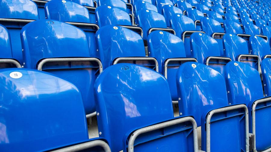 Full frame shot of empty blue seats at stadium
