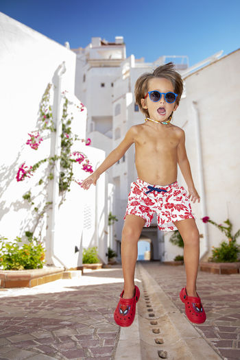4 years old jumper This Is Natural Beauty Child Portrait Full Length Childhood Smiling City Summer Looking At Camera Standing Front View