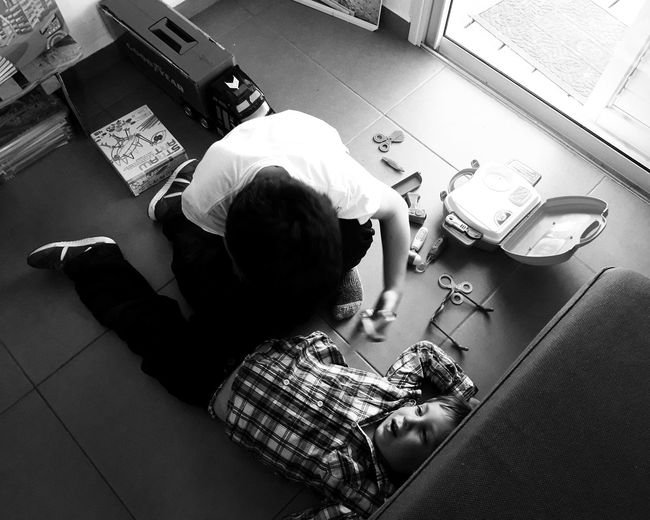 High angle view of boy sitting in kitchen