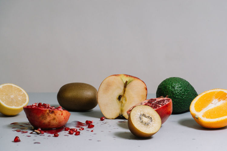 Close-Up Of Fruits On Table Against Gray Background