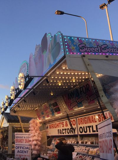 Low Angle View Outdoors Amusement Park Commercial Sign Sweet Stall Cotton Candy Shop Brandy Snap Candy Floss Hull Fair Hull City Of Culture 2017 Fun Fair Fairground