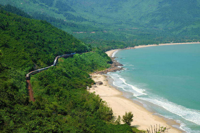 Panorama scene of Lang Co beach, Hue from Hai Van mountain pass at Da Nang, Viet Nam. Amazing landscape of train moving on railway at seaside, nice view of nature with green forest, wave on sea ASIA Asian  Beach Beautiful Da Nang Danang Forest Hai Van Hai Van Pass Huế Jungle Lang Co Beach Mountain Pass Mountains Nature Railroad Railway Sea Seaside Train Transport Transportation Viet Nam Vietnam Vietnamese