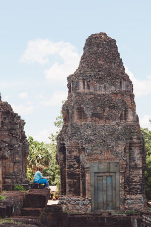 Siem Reap Cambodia Angkor Curly Hair Girl Built Structure Architecture Building Exterior Travel History Religion Tourism Ancient Travel Destinations The Past Sky Real People Place Of Worship Building Spirituality Old Ruin Nature Sitting Day Ancient Civilization Outdoors Ruined Archaeology