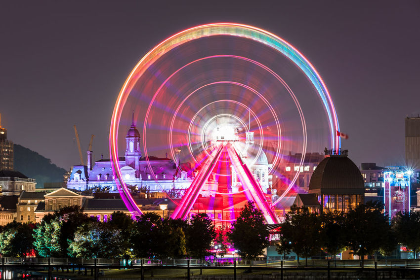 The Montreal Observation wheel, Montreal, Quebec, Canada! La Grande Roue De Montréal Montreal Observation Wheel Amusement Park Amusement Park Ride Architecture Arts Culture And Entertainment Building Exterior Built Structure City Fairground Ferris Wheel Glowing Illuminated Motion Multi Colored Multicolors  Nature Night No People Outdoors Sky Spinning Spinning Wheel Travel Destinations Tree