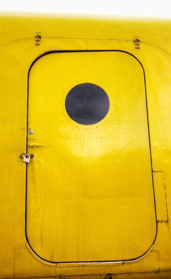 Low angle view of yellow metallic door