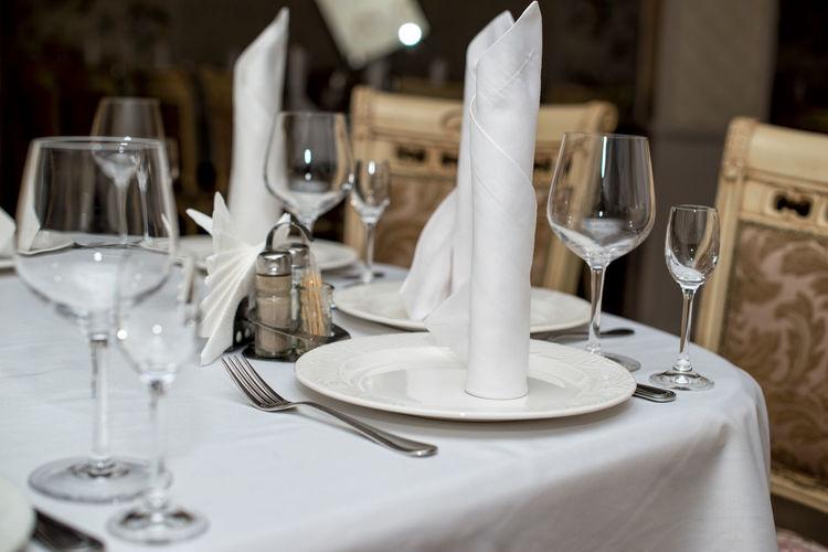 Drinking glasses on table in restaurant