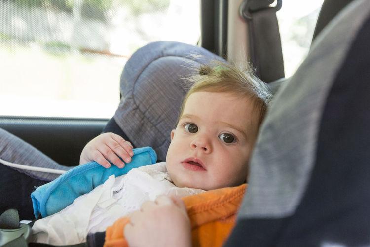 Portrait of cute baby in car