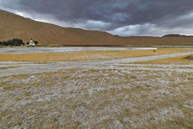 1105 sumu jaran lakebed among the badain jaran desert sand dunes. inner mongolia-china.