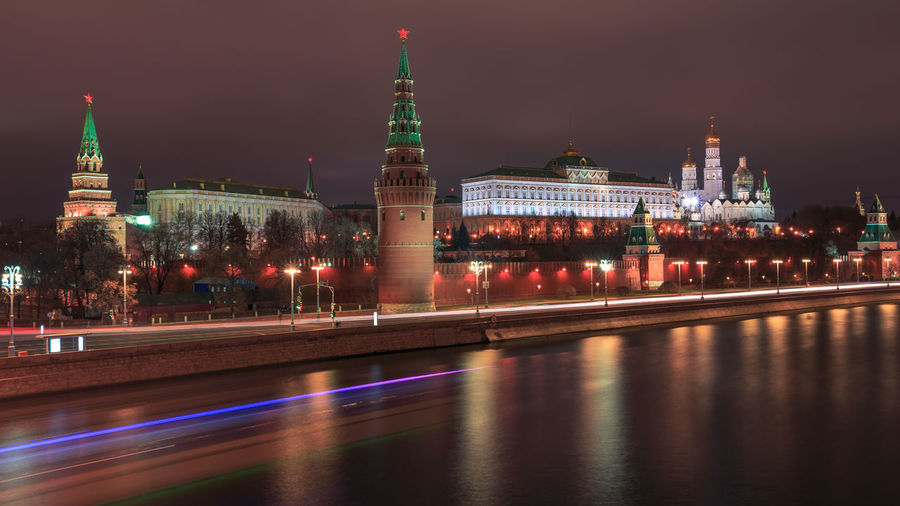 The Kremlin in Moscow at night with the Moskva river Built Structure Building Exterior Architecture Illuminated Night Travel Destinations Motion Light Trail Long Exposure Tower Water Building Blurred Motion City Travel Tourism Waterfront No People Government Outdoors Kremlin Moscow Politics And Government Moskva Russia
