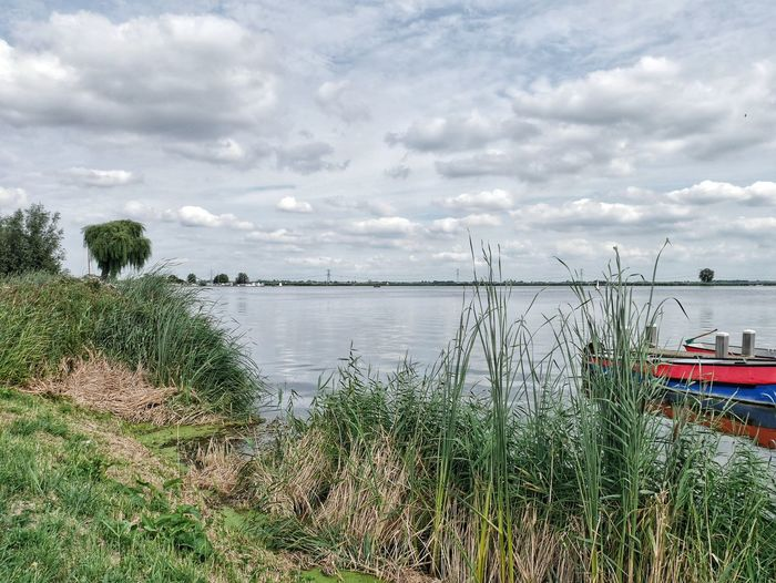 Sky Water Lake Cloud - Sky Boat Trees Grass Landscape Tranquility Tranquil Scene Scenics Horizon Over Water Outdoors Day Summer Ladyphotographerofthemonth Landscapes With WhiteWall