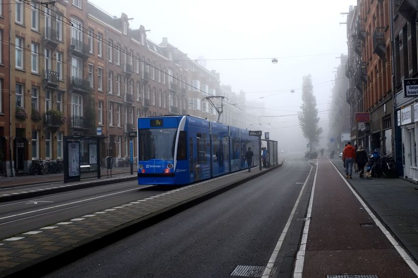 EyeEm In Amsterdam Architecture Building Exterior Built Structure City Day Mode Of Transport No People Outdoors Public Transportation Rail Transportation Railroad Track Sky Train - Vehicle Transportation Travel