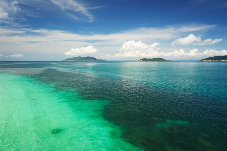 Crystal clear and turquoise sea water of the tropical sea . Bay Beach Beautiful Blue Blue Sky Calm Caribbean Chair Coast Coastline Day Dream Hot Idyllic Island Lagoon Malaysia Nature Nobody Ocean Outdoor Panorama Paradise Parasol Rawa Relax Resort Sand Scenery Scenic Sea Seascape Shore Sky Speed Boat Summer Sun Sunlight Sunny Tourism Tranquil Travel Tree Tropic Tropical Vacation Water White Cloud