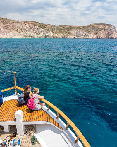 Sea Vacations Two People Relaxation Travel Destinations Nature People Water Women Sitting Greece Greek Milos Greek Island Summertime Milos Travel Grece Milos Island Greecesummer Summer Milos, Greece Travelling Blue Sun