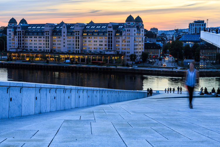 Connected By Travel Opera House Oslo Architecture Bridge - Man Made Structure Building Exterior Built Structure City Day Large Group Of People Nature Outdoors People Real People River Sky Sunset Travel Destinations Water