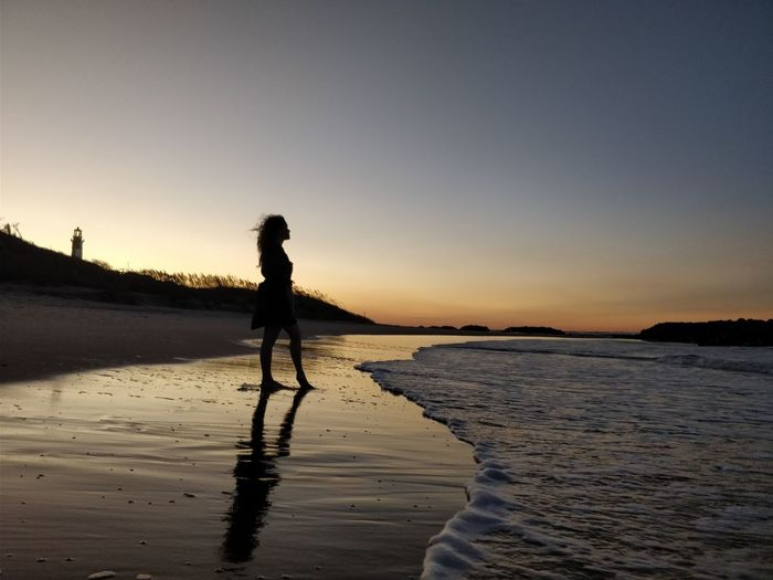 Beach Beauty In Nature Clear Sky Day Full Length Leisure Activity Nature One Person Outdoors People Real People Sand Scenics Sea Silhouette Sky Standing Sunset Tranquil Scene Tranquility Vacations Water Women EyeEmNewHere