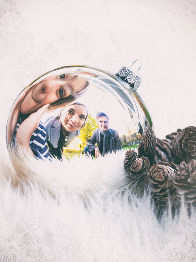Real People Lifestyles Portrait Men Mid Adult Reflection Males  Adult Indoors  Mid Adult Men Women People Leisure Activity Mirror Front View Celebration Headshot Mid Adult Women Young Adult Christmas Decoration Vintage Family Christmas