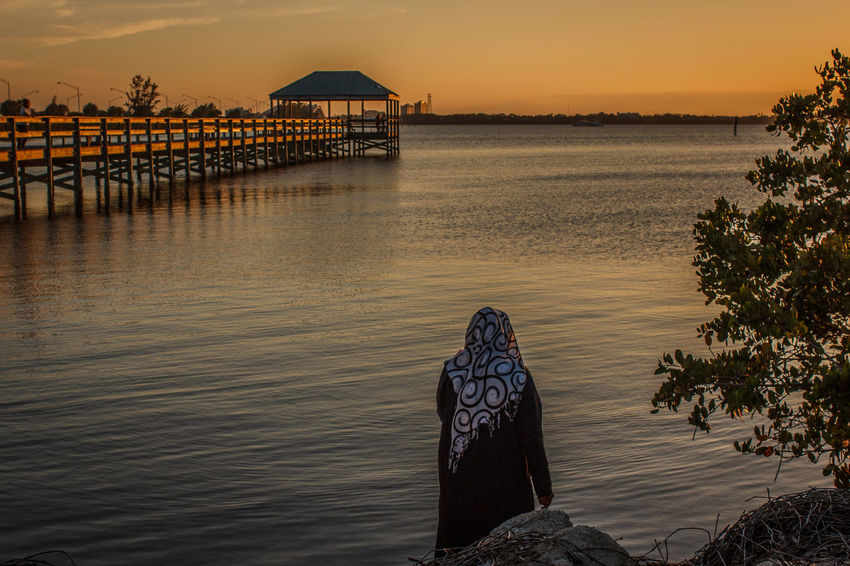Sunset devotions Beauty In Nature Horizon Over Water Indian River Lagoon Indian River Lagoon Sunset Leisure Activity Lifestyles Nature One Person Outdoors Real People Relaxation Sea Sky Sunset Tranquil Scene Tranquility Water Woman