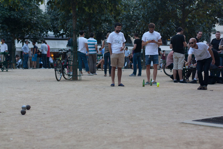 Boule on Place Dauphine Bicycle Boule Capital Casual Clothing City Enjoyment Europe France French Friendship Full Length ILE DE LA CITE Leisure Activity Lifestyles Men Paris Petanque Place Dauphine Playing Real People Recreational Pursuit Sport Togetherness Travel Weekend Activities