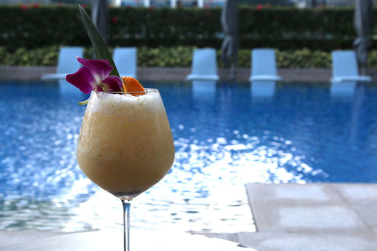 Drink against swimming pool