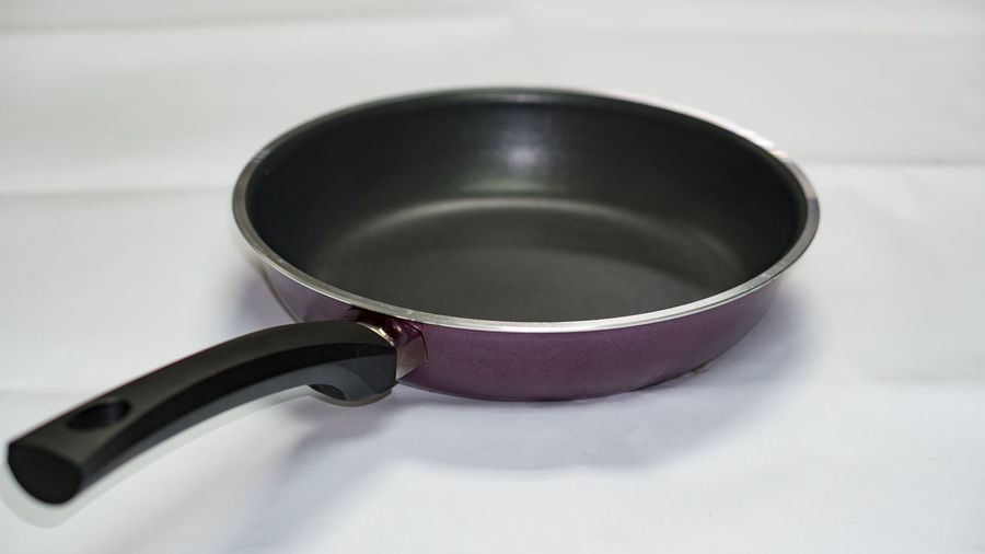 Black pan on white background Alloy Black Color Clean Close-up Cooking Pan Empty Food And Drink Handle High Angle View Household Equipment Indoors  Kitchen Utensil Metal No People Pan Saucepan Silver Colored Single Object Stainless Steel  Steel Still Life Studio Shot Table White Background