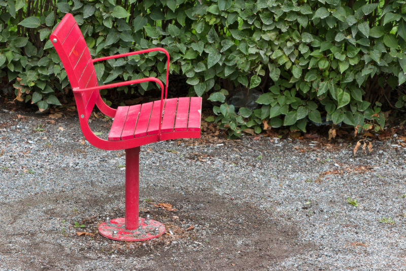 swivel chairs in a park Park Bench Colorful Day Empty Nature No People Outdoors Park Park Chair Red Revolving Chair Swivel Chair