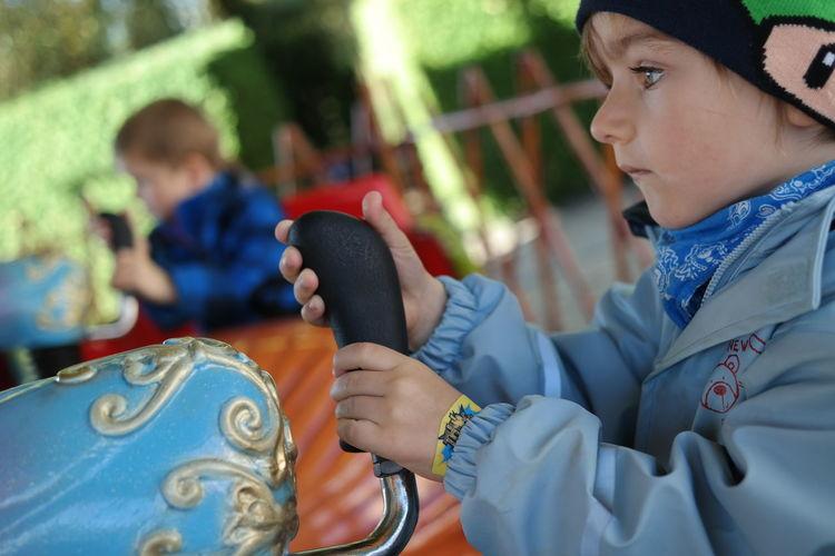 Boy enjoying bumper car at amusement park