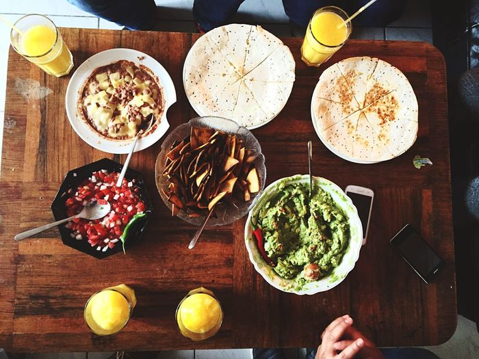 High Angle View Of Mexican Food Served On Table At Home