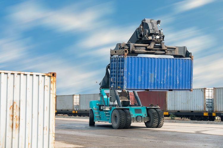 Forklift containers Business Container Ship Forklift Goods Industrial Logistics Transport Cargo Container Commercial Dock Commercial Land Vehicle Container Day Freight Transportation Industry Mode Of Transport Outdoors Semi-truck Shipping  Sky Stack Stack Containers Transportation Warehouse