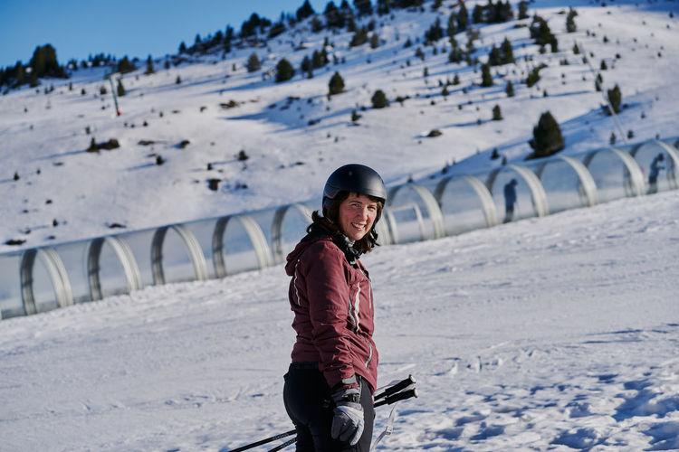 Full length portrait of girl standing on snow covered landscape