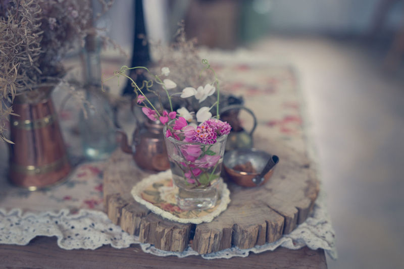 Close-up of pink roses in glass vase on table