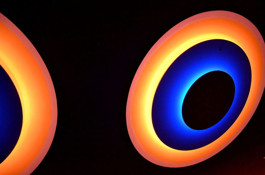 Neon Life Stillleben Multi Colored Orange Color Black Background Close-up Ring Of Light Streetphotography Lightsign Couleurs Coulor Of Life Berlin Photography Colorsplash