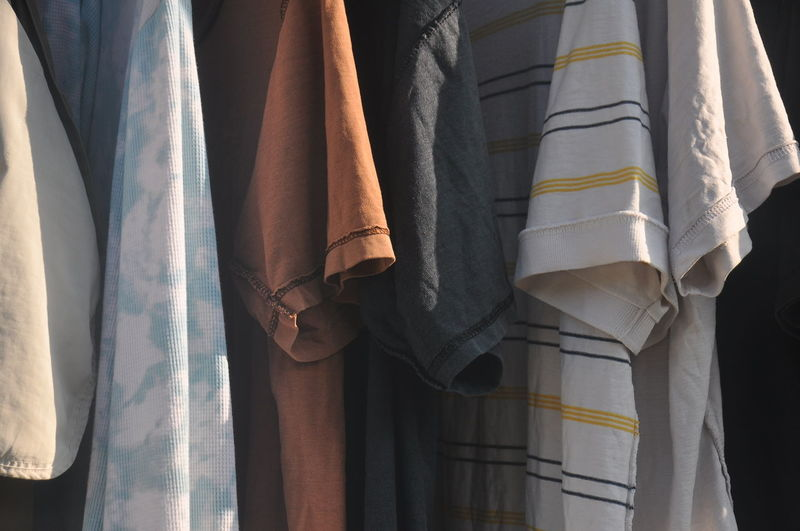 Close-up of clothes hanging on curtain