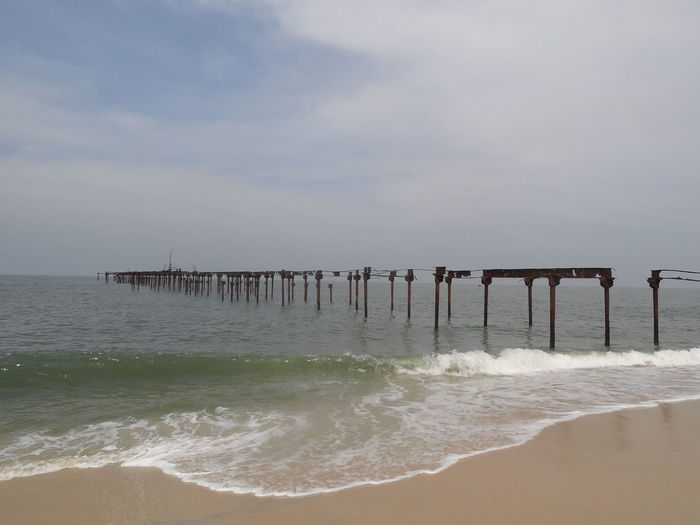 Abandoned Pier Over Sea Against Sky
