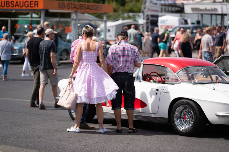 Lohmar, Germany - August 12, 2018: Visitors and historic US cars populate a huge parking lot - for editorial use only City Car Transportation Street Real People Mode Of Transportation Women Motor Vehicle Group Of People Lifestyles Adult Incidental People Men Land Vehicle Leisure Activity People Day Architecture Road Focus On Foreground Outdoors