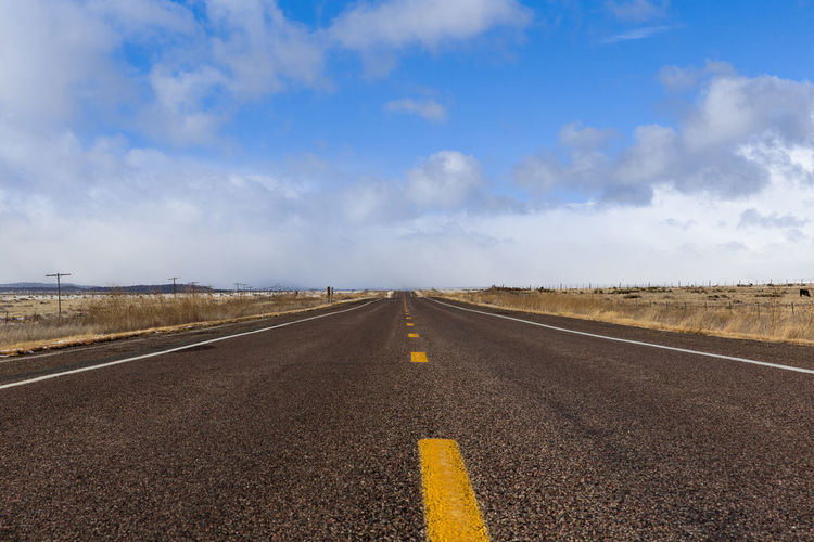 Cloud - Sky Diminishing Perspective Direction Dividing Line Environment Highway Horizon Horizon Over Land Land Landscape Marking Nature No People Outdoors Road Road Marking Sign Sky Straight Symbol The Way Forward Transportation vanishing point